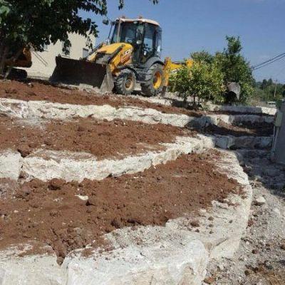 עיצוב גינות  פיתוח שטח בניית מסלעה